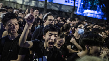 Protesters in Hong Kong chant outside the office of the Chief Executive.