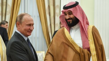 Russian President Vladimir Putin, shakes hands with Saudi Arabian Crown Prince Mohammed bin Salman during their meeting in Moscow in June.