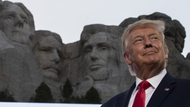 President Donald Trump smiles at Mount Rushmore National Memorial in South Dakota on July 3.