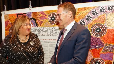 BHP CEO Andrew Mackenzie with  Professor Megan Davis, pro vice-chancellor Indigenous at UNSW, and the Uluru Statement from the Heart.