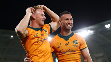 Quade Cooper, right, celebrates with Reece Hodge after kicking the winning penalty last weekend.