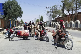 Taliban fighters patrol inside the city of Ghazni on Thursday.