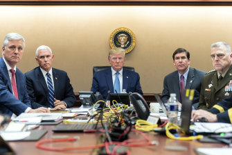 The Situation Room of the White House monitoring developments on Saturday as US Special Operations forces close in on Abu Bakr al-Baghdadi's compound in Syria. Pictured are US President Donald Trump (centre), Vice-President Mike Pence (second from left), national security adviser Robert O'Brien (left), Secretary of Defence Mark Esper (second from right)  and chairman of the Joint Chiefs of Staff Army Gen. Mark A. Milley (right).