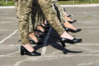 The soldiers wear heels while taking part in the the military parade rehearsal in Kyiv.