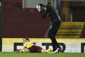 Liverpool goalkeeper Alisson reacts after fouling Ashley Barnes of Burnley, leading to the latter's match-winning penalty.