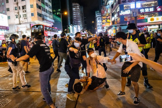 Undercover police arrest attendees of a memorial vigil for the victims of Tiananmen Square in Mongkok, Hong Kong, on Thursday.