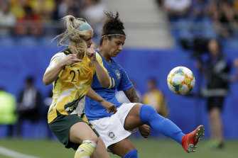 Australia's Ellie Carpenter battles with Brazil's Cristiane.