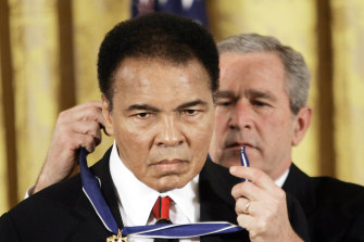 In 2009, US president George W Bush presents the Presidential Medal of Freedom to Muhammad Ali.