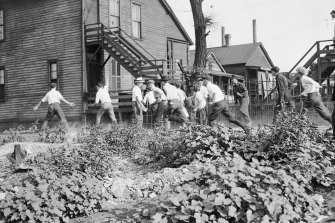 A mob of white men sets upon a victim n Chicago in 1919. Hundreds of African Americans died at the hands of white mobs in the riots.