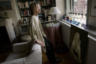 """Joan Didion (pictured in her apartment in 2005) has said that when she's nearing the end of a book, she needs to """"sleep in the same room as it""""."""