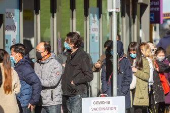 People queue for COVID-19 vaccines at Sunshine Hospital.