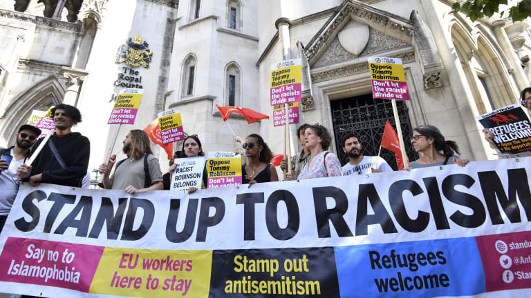 Demonstrators against far-right activist Tommy Robinson protest outside London's  Royal Courts of Justice last week. Robinson was released on bail while he appeals a 13-month jail sentence for live-streaming outside a criminal trial in violation of reporting restrictions.