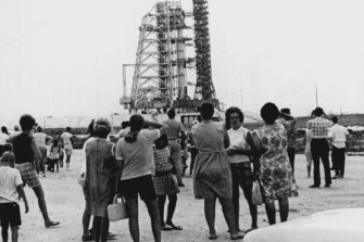 Tourists mill around near the Apollo-11 launch complex July 14, 1969.