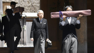 Japanese Emperor Akihito, centre, visits Ise Grand Shrine on Thursday. This is the last trip to a local region for the Emperor and Empress before his abdication.