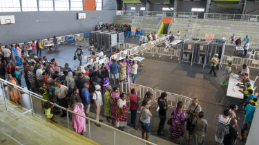 Residents of New Caledonia's capital, Noumea, wait in line to cast their vote in the independence referendum.