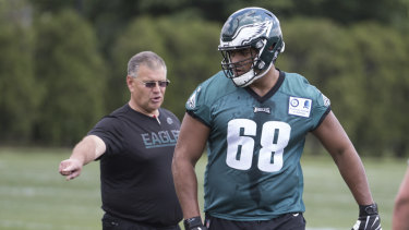 Guidance: Philadelphia's offensive lineman Jordan Mailata getting some instruction from Jeff Stoutland.