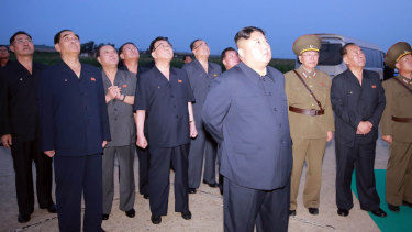 In this August 6, 2019 photo provided by the North Korean government, Kim Jong-un visits an airfield in the western area of North Korea to watch its weapons demonstrations.