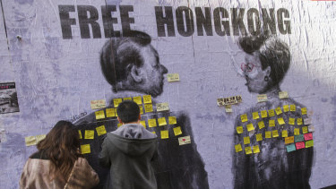 Hundreds of people posted sticky notes in support of Hong Kong pro-democracy protesters over a mural by Chinese-Australian artist and activist Badiucao in Hosier Lane.