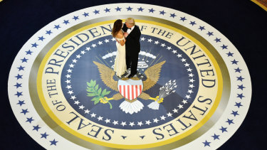 President Donald Trump and first lady Melania Trump dance during one of the many inauguration day events in Washington on January 20, 2017.