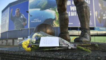 Flowers left on the statue of former Cardiff City soccer player Frederick Charles Keenor following the disappearance of new signing Emiliano Sala.
