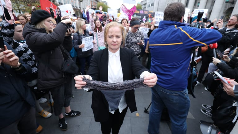 Irish politician Ruth Coppinger holds a pair of underwear during a protest in support of victims of sexual violence in Dublin on Wednesday November 14, 2018.