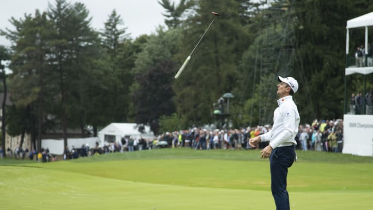 Frustration: Justin Rose tosses his club after missing a putt for par on the 18th hole.