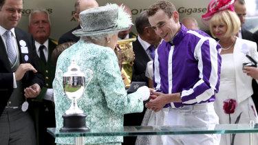 Marquee man: Queen Elizabeth II presents a medal to jockey Ryan Moore after his Diamond Jubilee victory.
