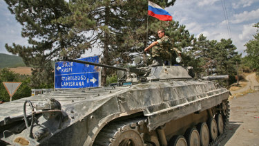 A Russian soldier sitting on a tank in the Georgian town of Igoeti in 2008.
