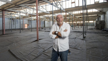 A bit quiet at present: Caretaker Vern Anagnostou in the vast former Younghusband wool store's show room in Kensington.
