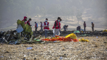Rescuers work at the scene of the Ethiopian Airlines flight, outside Addis Ababa.