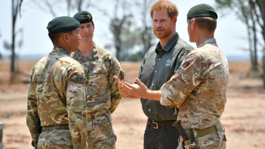 Prince Harry at the memorial site dedicated to guardsman Mathew Talbot in Liwonde National Park. Mr Talbot lost his life on an anti-poaching patrol in May.