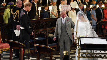 Meghan Markle accompanied by Prince Charles.