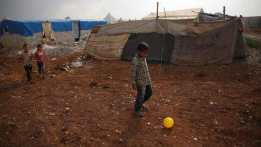 Syrian children play last month in a camp for displaced people on the outskirts of Jarablus, one of the Syrian towns under the control of Turkish-backed forces.