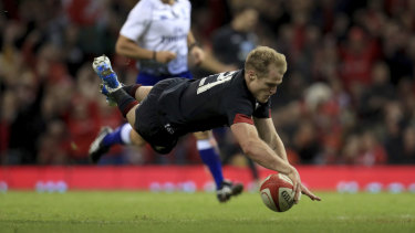 Welshman Aled Davies crosses for a try in their victory over Tonga.
