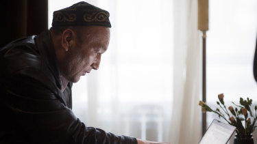 Omir Bekali looks at a computer to trace the location of the Chinese internment camp where he was held.
