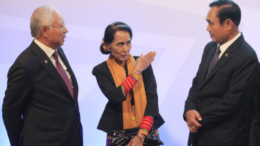 Myanmar's Aung San Suu Kyi, centre, with Thailand's Prime Minister Prayut Chan-o-Cha, right, and Malaysia's Najib in Manila last year.