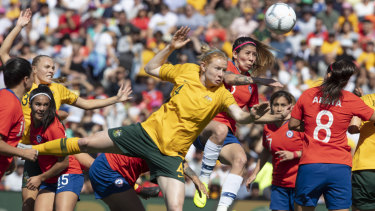 One-way traffic: Maria Jose Urrutia of Chile clears the ball during an onslaught from the Matildas.