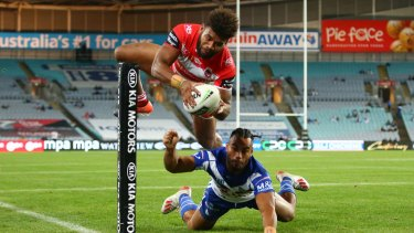Jumping at the chance: Mikaele Ravalawa has scored seven tries in his brief career but none more spectacular this.