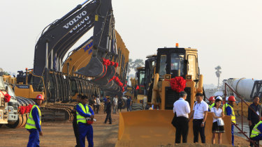 Construction machines line up during a ground-breaking ceremony to build Cambodia's first expressway.