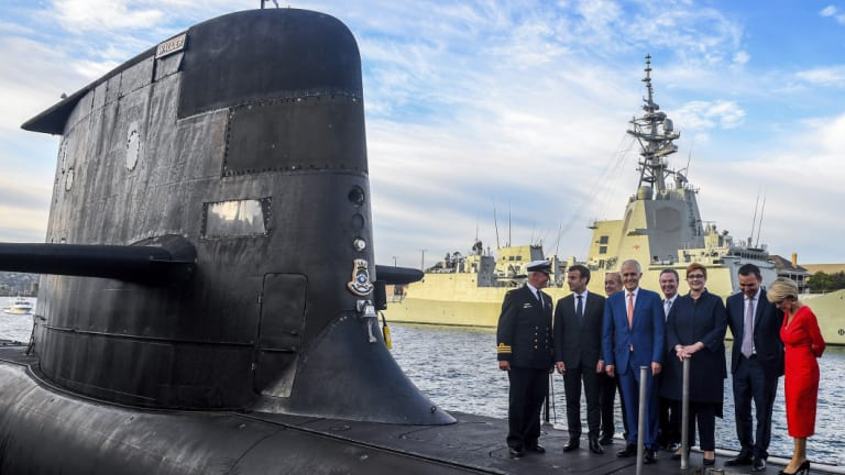 Prime Minister Malcolm Turnbull and ministers on a submarine at Garden Island during a visit by French President Emmanuel Macron earlier this year.