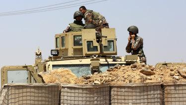 Jordanian troops patrol at the Jordanian side of Naseeb border crossing into Syria.