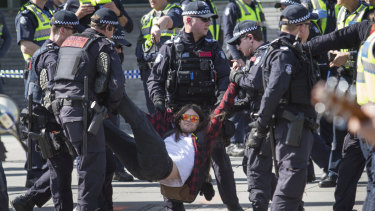 Police arrested about 36 protesters at a climate rally in Melbourne on Saturday afternoon.