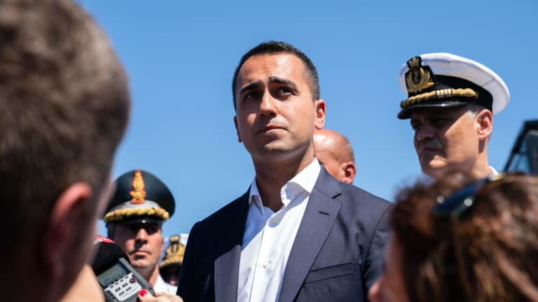 Luigi Di Maio, Italy's deputy prime minister, speaks to the media as he visits the Morandi motorway bridge after it partially collapsed in Genoa, Italy.