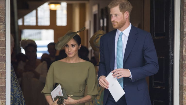 Prince Harry and Meghan, Duchess of Sussex, leave after the christening service.