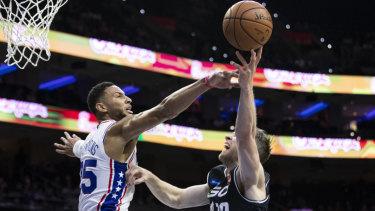 Australian Ben Simmons knocks away a shot playing for Philadelphia 76ers.