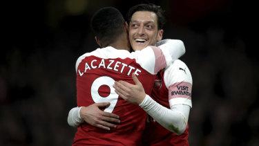 Mestu Ozil celebrates Alexandre Lacazette's goal against Bournemouth.