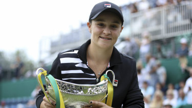 Soaring to new heights: Ash Barty poses with the trophy after beating Germany's Julia Goerges in the final of the Birmingham Classic.