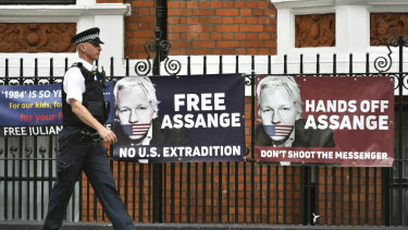 A police officer walks past the Ecuadorian embassy in London on Monday.
