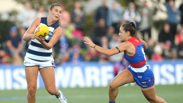 Geelong's Rebecca Webster feels the pressure from Bulldog Monique Conti.