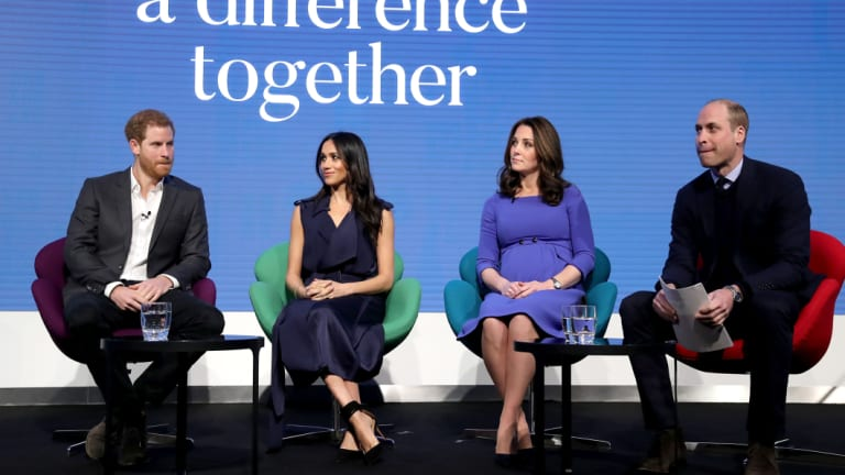 A demure Kate beside Markle, in a slinky sleeveless dress, with their husbands at a televised forum.